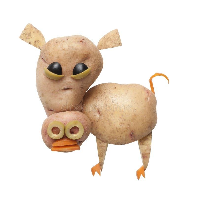 Cerdo divertido hecho de patatas fotos de archivo libres de regalías