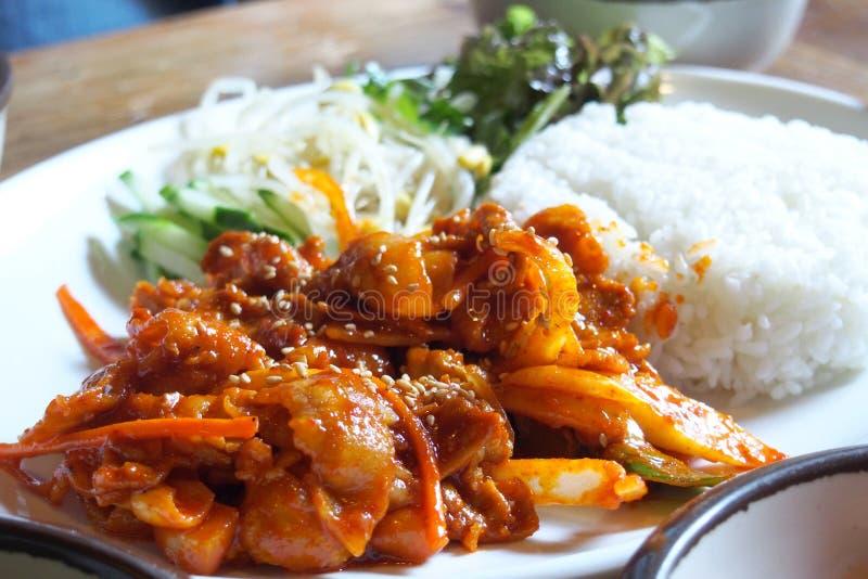 Cerdo sofrito de la salsa de Kim Chi con arroz fotos de archivo