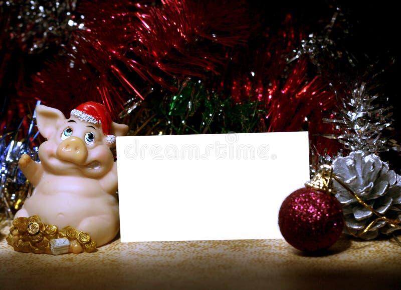 Cerdos y tarjeta con las bolas foto de archivo libre de regalías