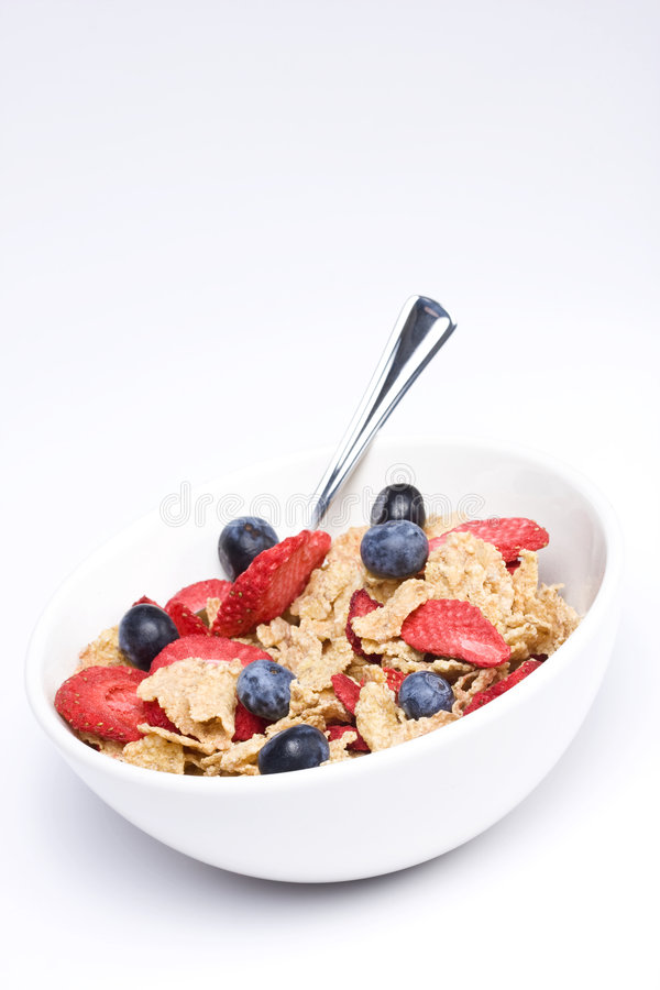 Cereal. A bowl of cereal with dried strawberries and blueberries royalty free stock photo