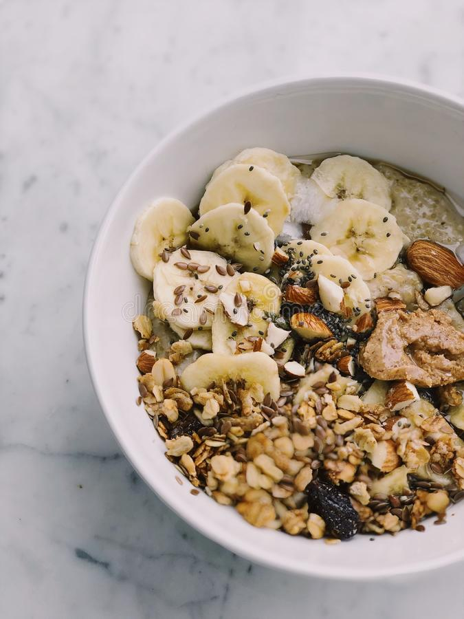 Cereal With Banana on White Bowl royalty free stock images