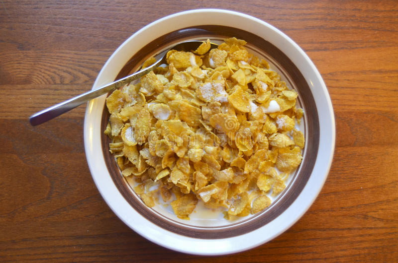 Cereal. A bowl of breakfast cereal flakes with milk and sugar royalty free stock images
