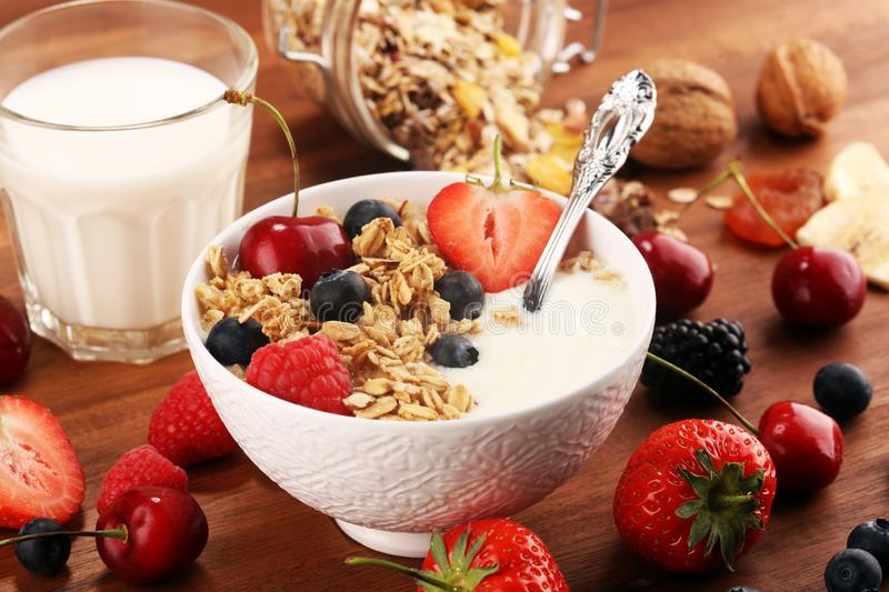 Cereal. Bowl of granola cereals, fruits and milk for breakfast. Muesli with cereals. Bowl of granola cereals, fruits and milk for breakfast. Oat flakes or royalty free stock images