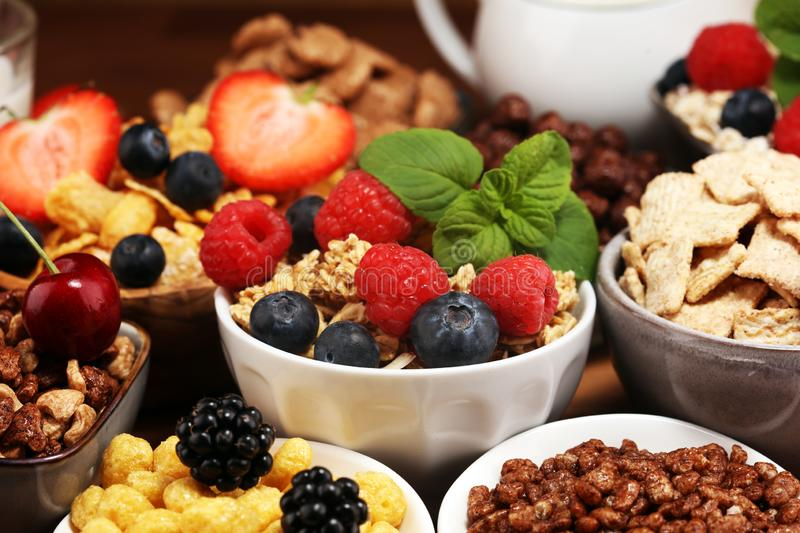 Cereal. Bowls of various cereals, berries and milk for breakfast. Muesli with kids cereals. Cereal. Bowls of various cereals, fruits and milk for breakfast stock photos