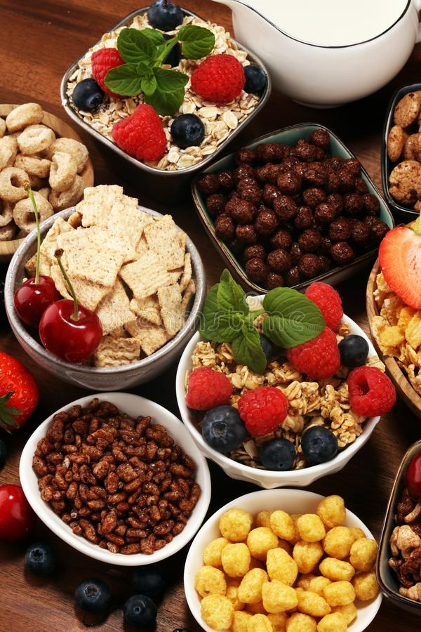 Cereal. Bowls of various cereals, berries and milk for breakfast. Muesli with kids cereals. Cereal. Bowls of various cereals, fruits and milk for breakfast royalty free stock photography