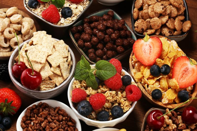 Cereal. Bowls of various cereals, berries and milk for breakfast. Muesli with kids cereals. Cereal. Bowls of various cereals, fruits and milk for breakfast stock image