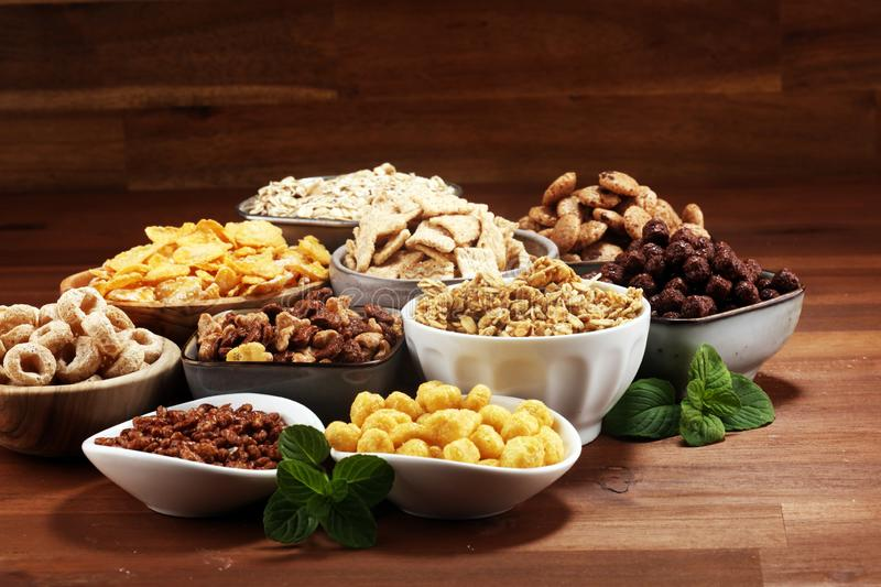 Cereal. Bowls of various cereals for breakfast. Muesli with kids cereals. Cereal. Bowls of various cereals for breakfast. Muesli with variety of kids cereals stock image