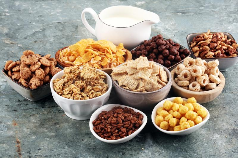 Cereal. Bowls of various cereals and milk for breakfast. Muesli with kids cereals. Cereal. Bowls of various cereals and milk for breakfast. Muesli with variety stock image