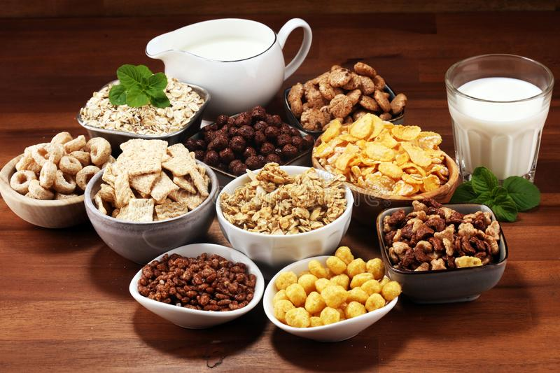 Cereal. Bowls of various cereals and milk for breakfast. Muesli with kids cereals. Cereal. Bowls of various cereals and milk for breakfast. Muesli with variety stock photo