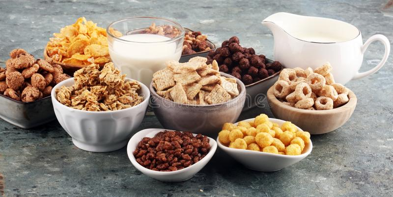 Cereal. Bowls of various cereals and milk for breakfast. Muesli with kids cereals. Cereal. Bowls of various cereals and milk for breakfast. Muesli with variety stock photos
