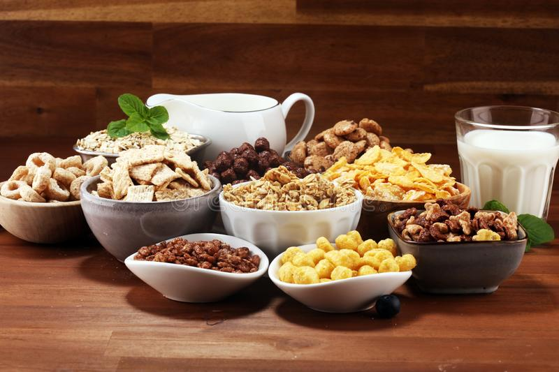 Cereal. Bowls of various cereals and milk for breakfast. Muesli with kids cereals. Cereal. Bowls of various cereals and milk for breakfast. Muesli with variety royalty free stock photos