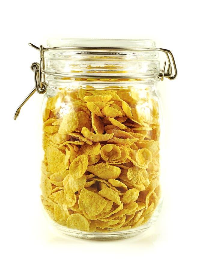 Cereal de los copos de maíz aislado en el fondo blanco fotografía de archivo libre de regalías