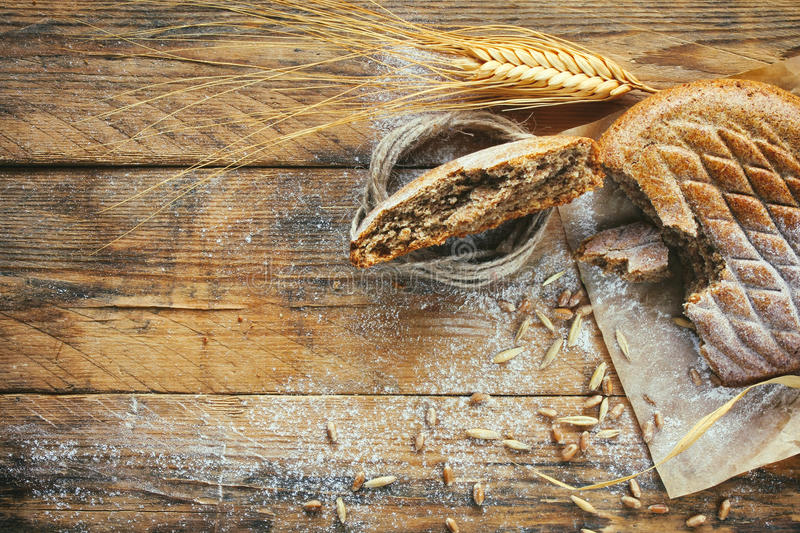 Cereal flapjack, ears of wheat and rye, corn, sprinkled flour stock photo