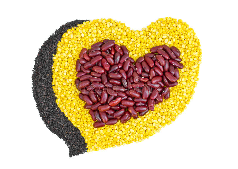 Cereal Grains in to a heart shaped, red beans, green beans, black sesame seeds. Cereal Grains in to a heart shaped, red beans, green beans, black sesame seeds royalty free stock photo