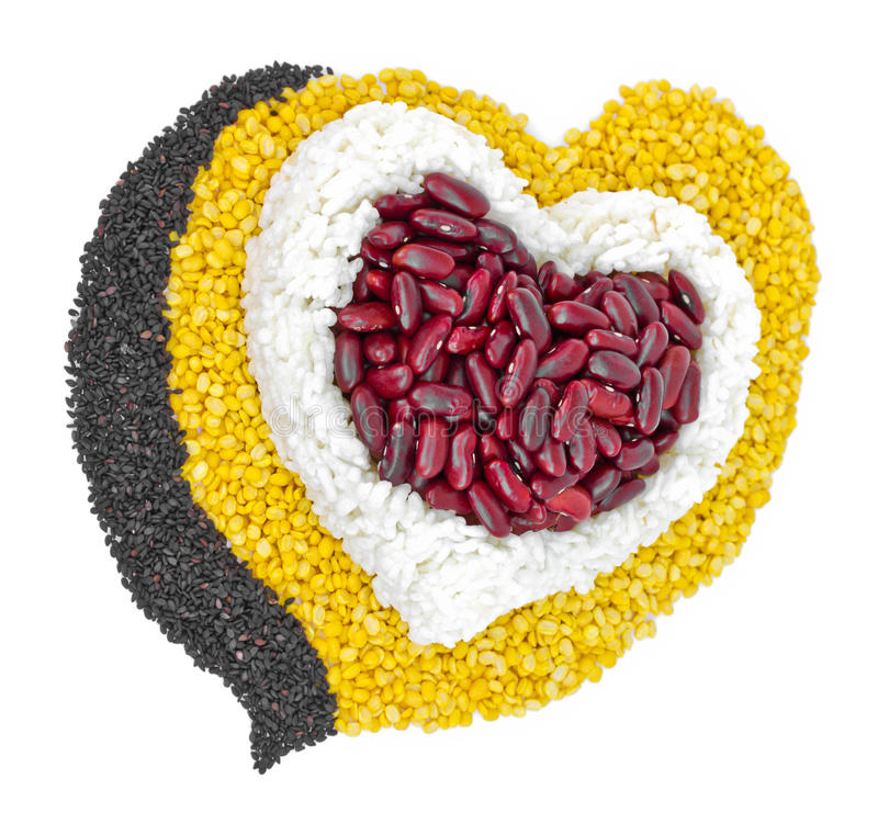 Cereal Grains in to a heart shaped, red beans, green beans, rice royalty free stock image