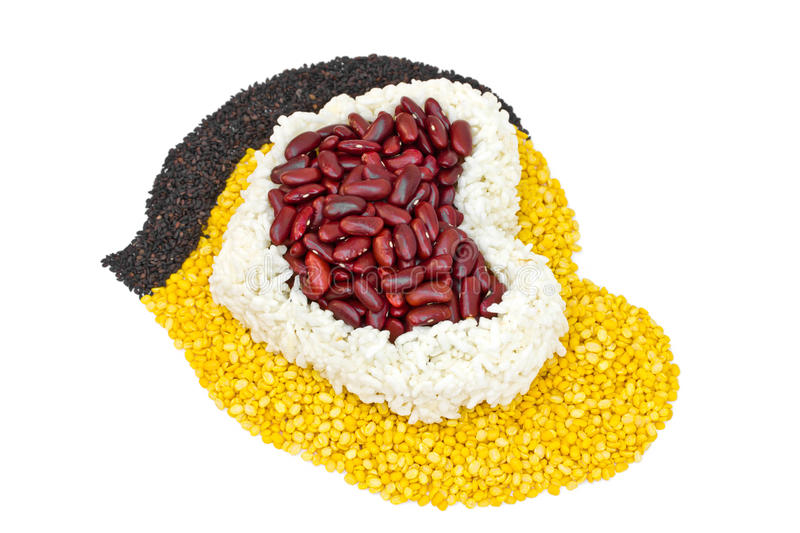 Cereal Grains in to a heart shaped, red beans, green beans, rice. Black sesame seeds on white background stock photo