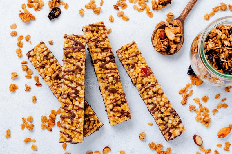 Cereal granola bar with nuts, fruits and berries on a whhite stone table. Granola bar. Healthy snack. stock photo