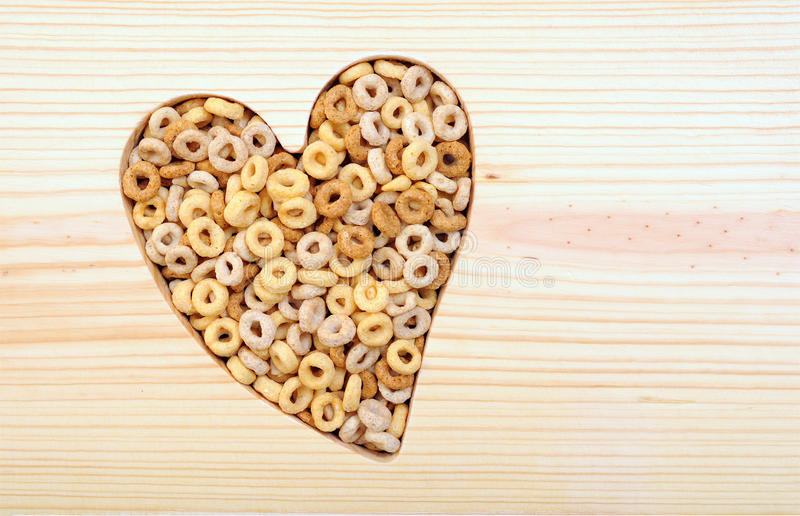 Cereal in heart shape. With copy space for design stock photo