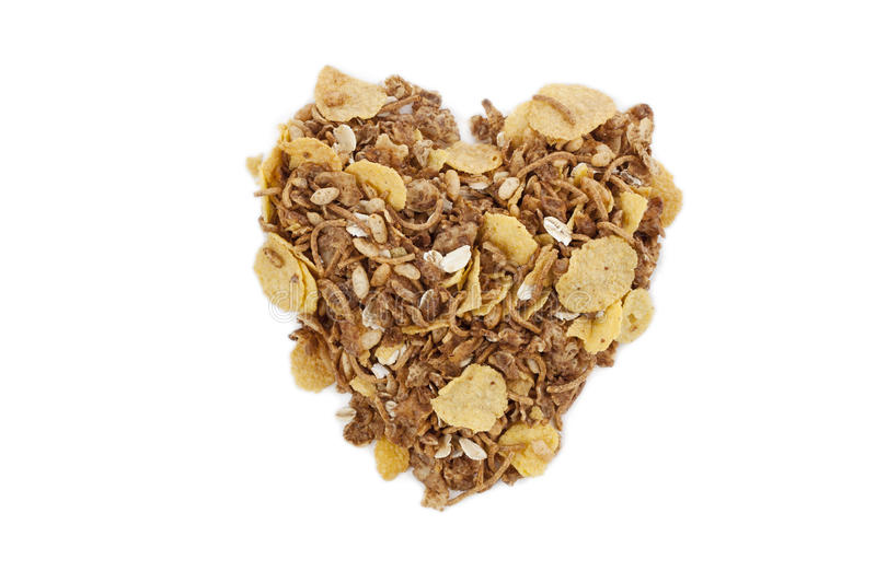 Cereal on a heart shaped. And background breakfast royalty free stock image