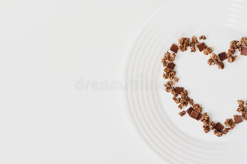 Cereal muesli breakfast on white background. Healthy eating and lifestyle concept stock image