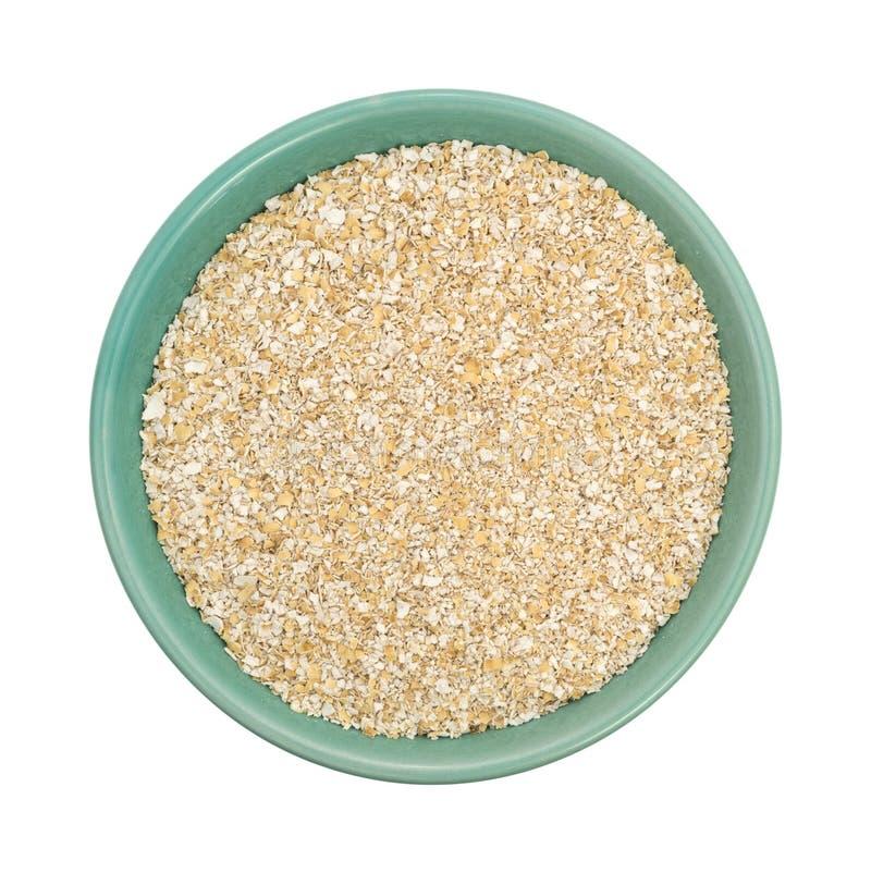 Cereal quente do farelo seco da aveia em uma bacia verde imagens de stock