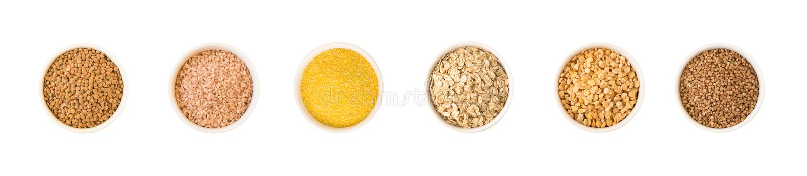 Cereal and seeds in round ceramic plates. stock photos