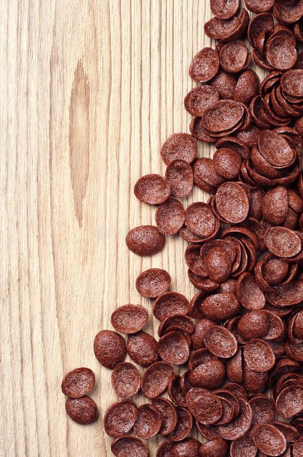 Cereali del cioccolato sulla tavola di legno immagine stock libera da diritti