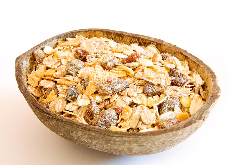 Cereals. Half coconut with cereals inside royalty free stock image