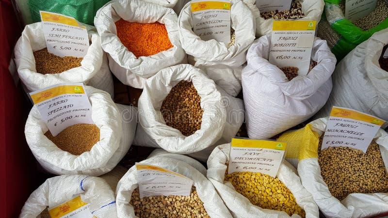Cereals lentils, spelled, beans, broad beans at the Castelluccio market. Castelluccio di Norcia. Apennines, Umbria, Italy. Cereals lentils, spelled, beans, broad stock photos