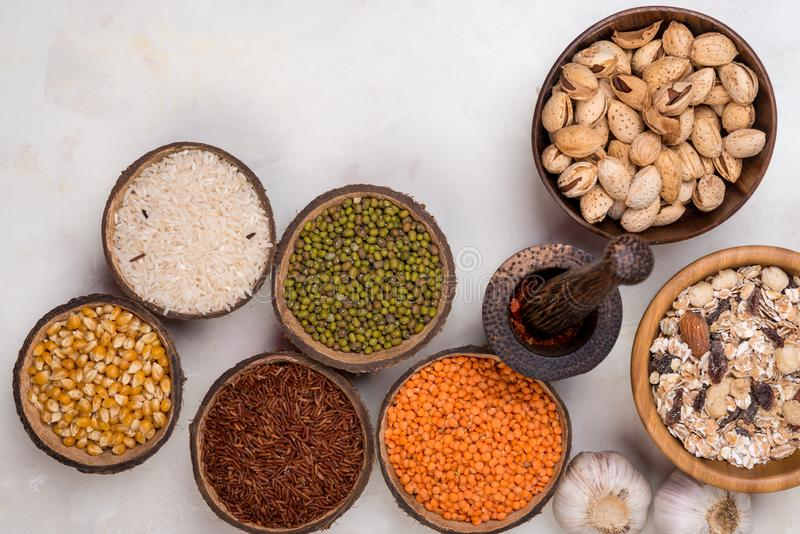 Cereals, seeds, beans, grains in a bowls on white table royalty free stock photo