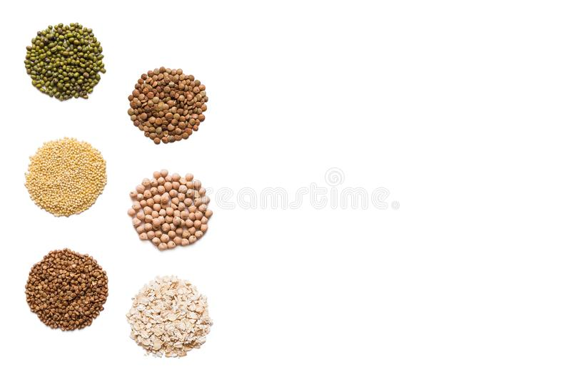 Cereals set isolated. Composition with different grains and cereals: rice, buckwheat, millet, peas, oatmeal, chickpeas, lentils stock image
