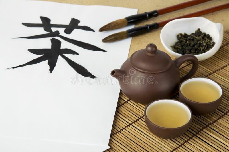 Ceremonia de té y caligrafía foto de archivo