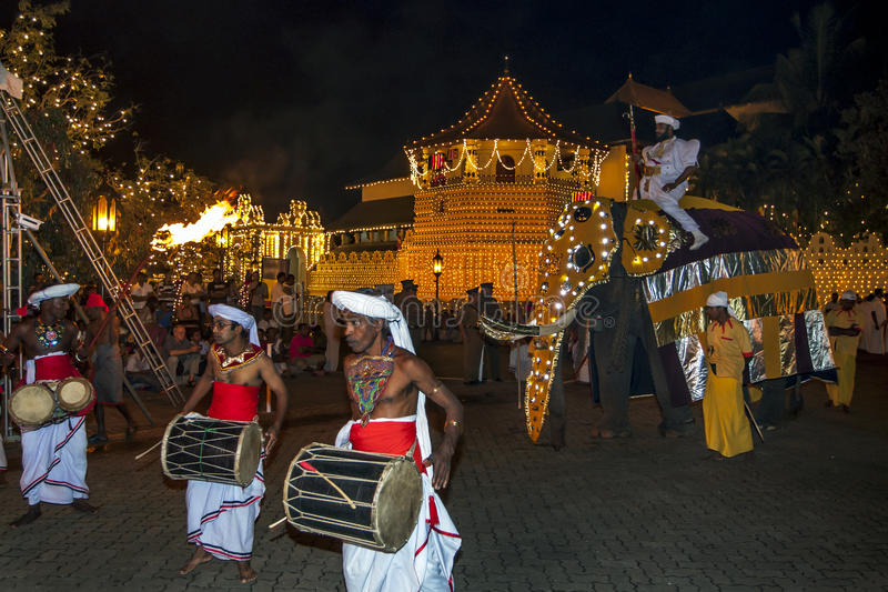 A ceremonial elephant parades past the Temple of the Sacred Tooth Relic in Kandy in Sri Lanka. stock image