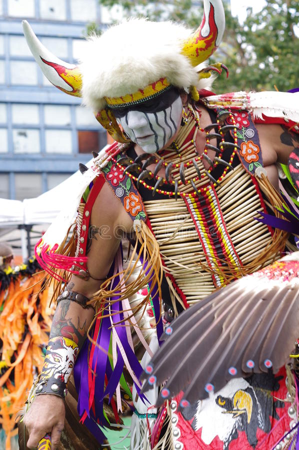 Ceremonial movements of a Pow-wow dancer stock image