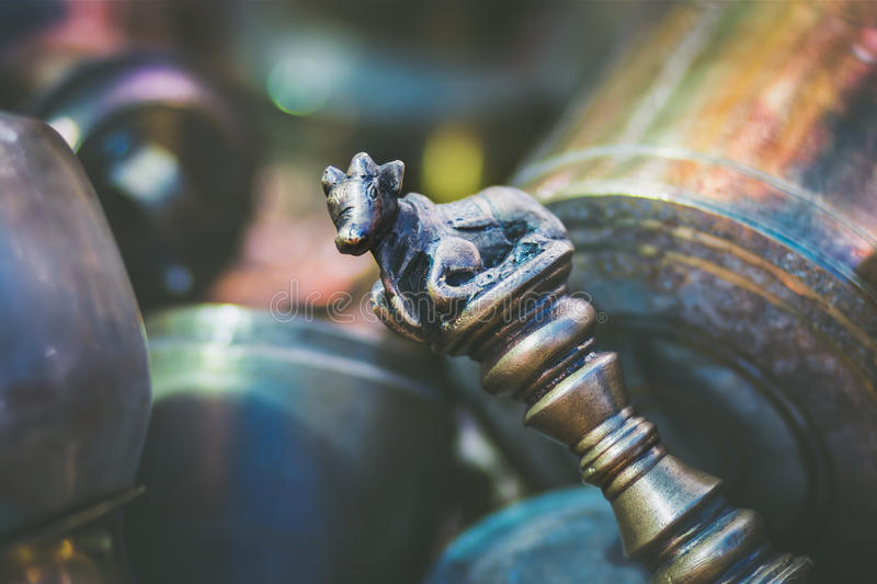 The ceremonial Nandi scepter. A vintage ceremonial metal scepter with the Hindu motif Nandi on top royalty free stock photography
