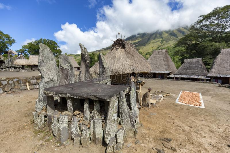 Ceremonial platform. A Megalithic ceremonial platform, Bhaga shrine and drying nuts in the center of the Bena traditional village, Flores, Indonesia stock photo
