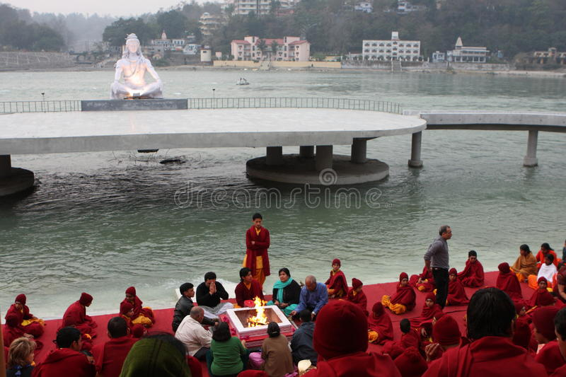 Ceremonial in Rishikesh. RISHIKESH, INDIA - JANUARY 19: Hindu students from the Parmath Niketan Ashram hold ceremonial lanterns during the daily aarti prayer on royalty free stock photography