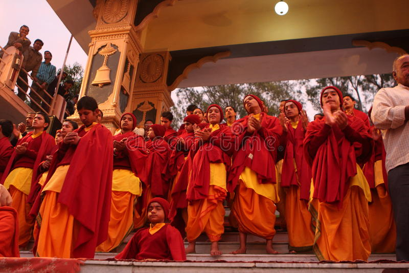 Ceremonial in Rishikesh. Hindu students from the Parmath Niketan Ashram hold ceremonial lanterns during the daily aarti prayer on the River Ganges in Rishikesh royalty free stock photography