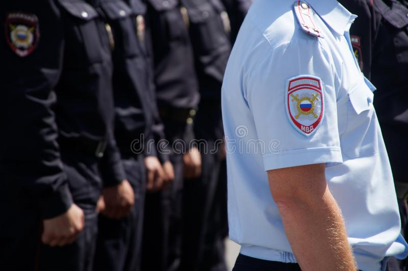 Ceremonial summer uniform of a patrol of the Russian police. Daylight. The inscription on the patch: police stock photography