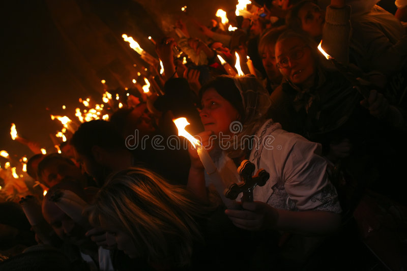 Ceremony of Holy Fire miracle. Pilgrims come to Holy Sepulchre for Holy Fire (Holy Light) miracle ceremony on Holy Saturday Apr 18, 2009 in Jerusalem, Israel stock photo