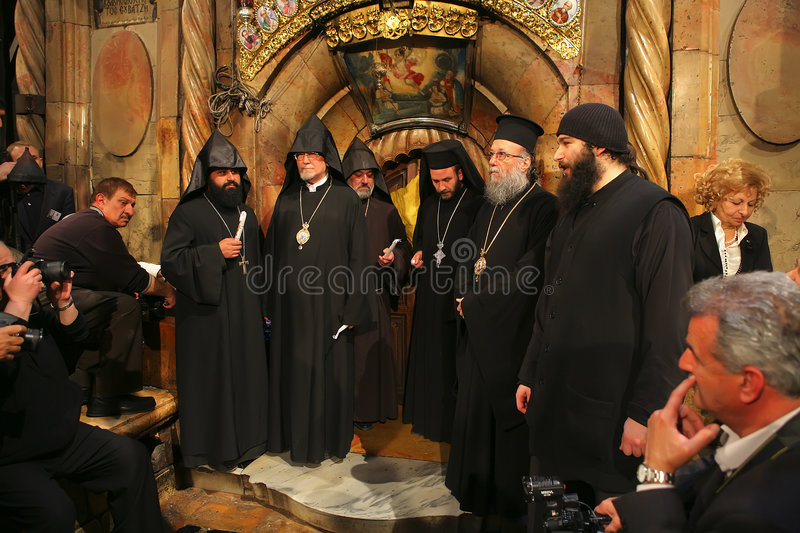 Ceremony of Holy Fire miracle. Orthodox and Armenian priests waiting in Holy Sepulchre for ceremony of Holy Fire (Holy Light) miracle on Holy Saturday stock photo