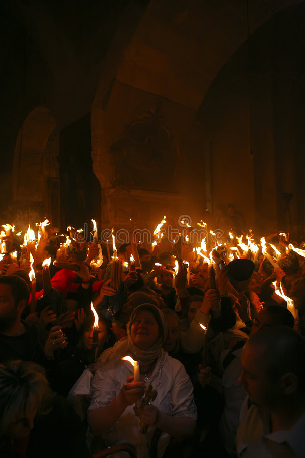 Ceremony of Holy Fire miracle. Pilgrims come to Holy Sepulchre for Holy Fire (Holy Light) miracle ceremony on Holy Saturday stock photo