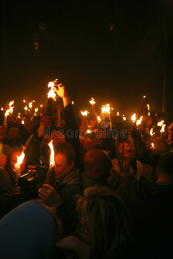 Ceremony of Holy Fire miracle. Pilgrims come to Holy Sepulchre for Holy Fire (Holy Light) miracle ceremony on Holy Saturday stock image