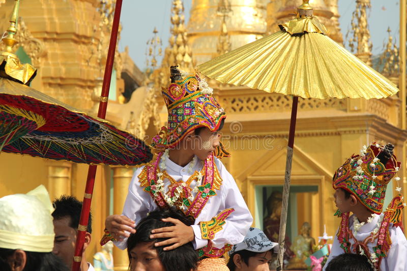 The ceremony of initiation of boys in monks in Myanmar. The ceremony of initiation of boys in monks in Myanmar, Yangon, Shwedagon stupa. Yang Boy in traditional stock photography