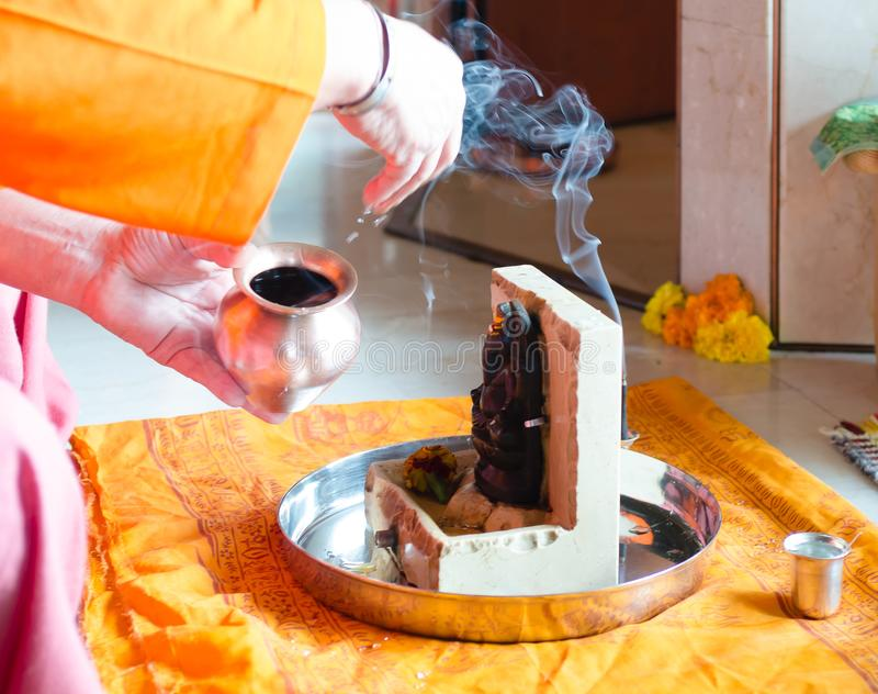 Puja to Lord Ganesh during the festival of Guru Purnima. Ceremony to Lord Ganesh during the festival of Guru Purnima. Water and incense are offered royalty free stock photos