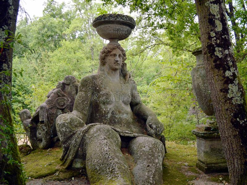Ceres in sacred grove. A shot of the Parco dei Mostri (Park of the Monsters or sacred grove), in Bomarzo (Viterbo, Italy) that shows Ceres statue. The gardens royalty free stock images