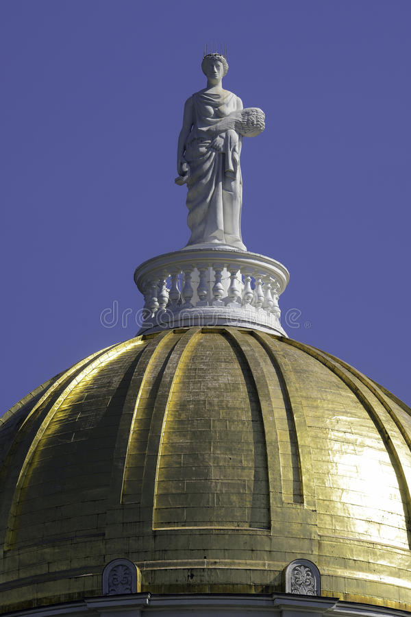 Ceres statue on Vermont Capitol Dome. Ceres statue on the dome of the Vermont State House at 115 State Street in Montpelier, Vermont on August 3, 2015 royalty free stock photo