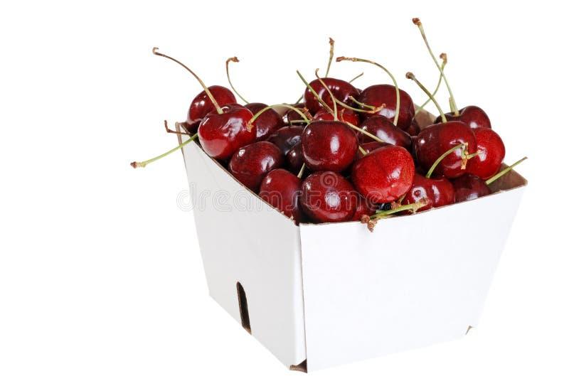 Cerezas frescas en un rectángulo imágenes de archivo libres de regalías