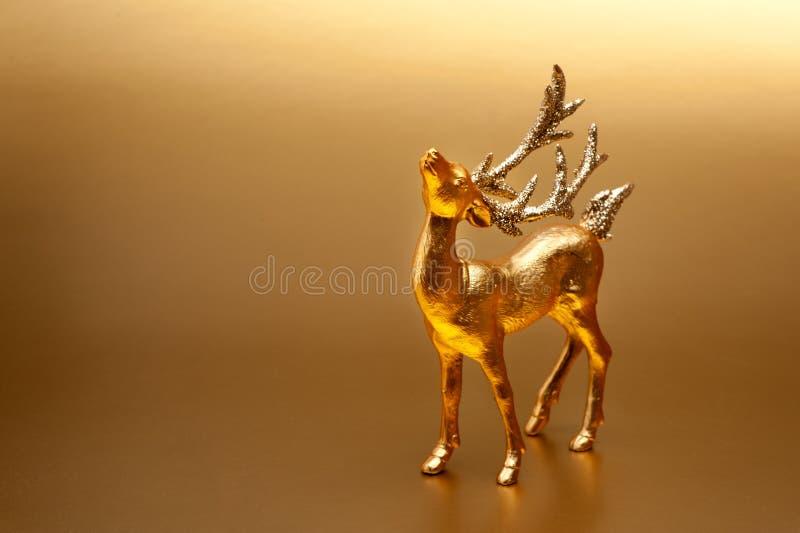 Cerfs communs d'or de carte de Noël photos libres de droits
