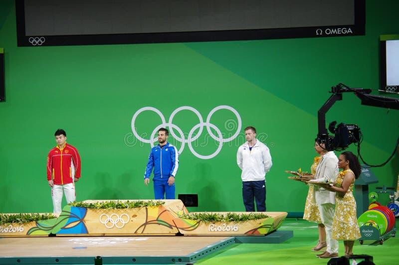 Cerimonia della medaglia di sollevamento pesi 85kg a Rio2016 immagini stock libere da diritti
